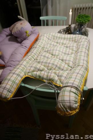 Babynest, skotskrutigt gult grönt grått Pysslan blogg